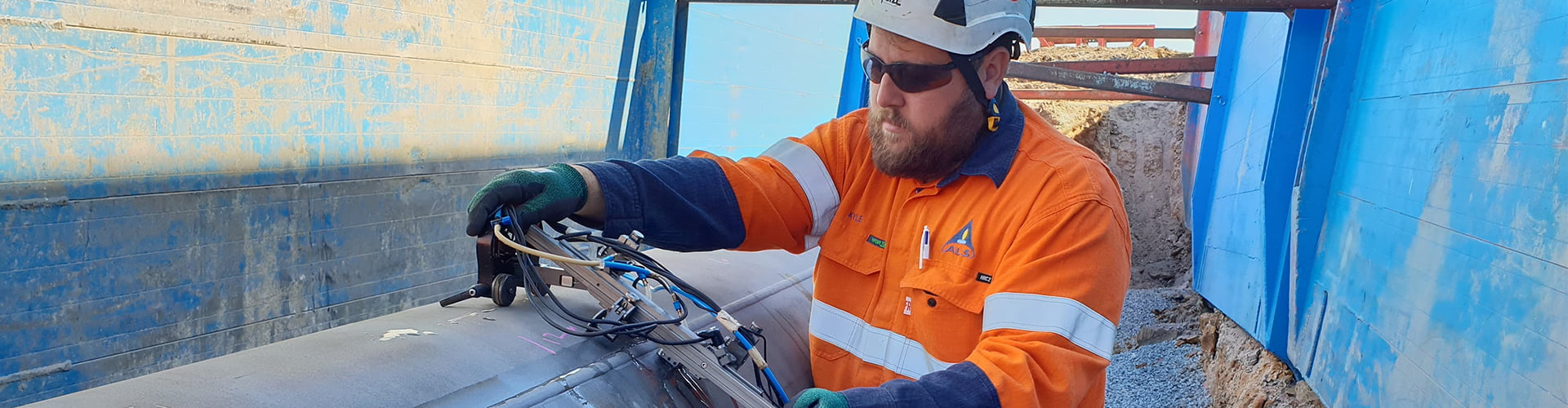 ALS technician performing a Phased Array Ultrasonic Testing (PAUT) on industrial piping