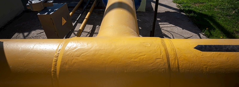 Pipe with yellow coating.