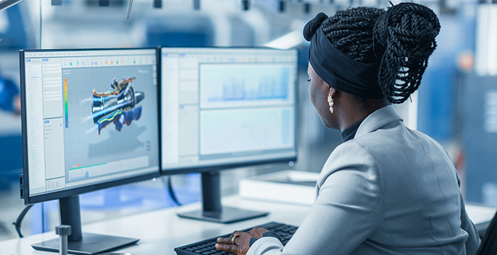 Female engineer sitting in front of computer.